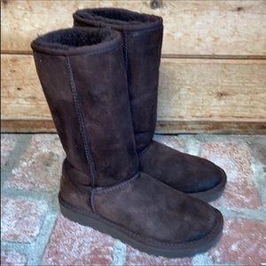Ugg brown leather tall leather boots.